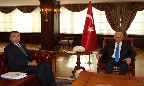 Başbakan Aziz Kocaoğlu'yla görüştü