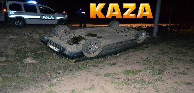 Otomobil takla atarak şarampole devrildi
